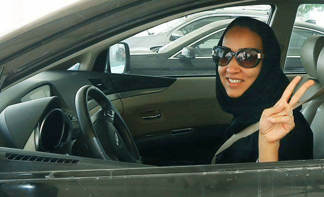 Saudi woman flashes the victory sign behind the wheel. Image source: Twitter