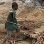 A Congo child mining for diamonds. Most diamond miners in Africa are children, being paid very little while being exposed to hazardous chemicals and conditions.