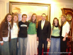 The Duggar girls with Bill Gothard, who sexually groomed dozens of teenage girls over several decades