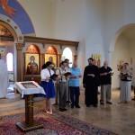 The Gospel (John 20:19-25) from right:  Italian, Russian, German, Serbian, Dutch, Latin, Arabic.