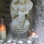"Glastonbury is pretty pagan these days.  Witches, fairies, water sprites, and all manner of widgie-widgie abound.  There was even some sort of ""worship"" going on at this statue of Mary when I first walked by ..."