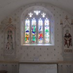 Inside the simple Chapel of St Patrick the walls have been restored to period.