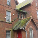 This is the rectory beside the church that Lewis attended as a boy.  Notice the door knob?  Look closer ...