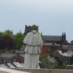 A bishop's statue stares across the way at St Patrick's Cathedral COI.