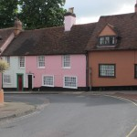 Catty-corner from the church, in pink, the Rectory.