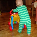 256px-Learning_to_walk_by_pushing_wheeled_toy