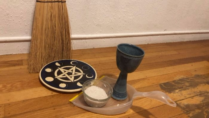 """Wiccan Trash"" or ""Time to sweep up my ritual stuff and throw it away."""