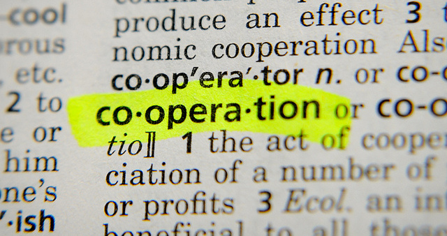 "Image of dictionary definition of ""cooperation."""
