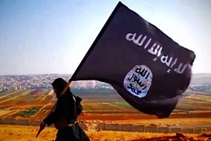 A militant with the black flag of ISIS. Image obtained through Creative Commons.
