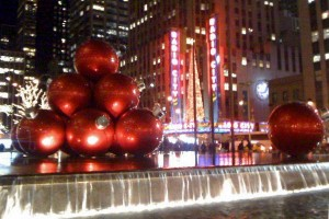 Christmas ornament sculpture at the McGraw-Hill Building, with Radio City Music Hall in the background. (c) 2011 Phil Fox Rose