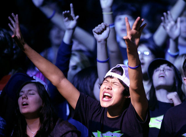 Jonathan Navaro, 15, of Kenosha, Wis., raises his hands in worship at the Convention Center, in La Crosse, Wis., on Friday October 30, 2009. These students were part of the 1700 youth that attended the Assemblies of God denomination Youth Convention for Wis. and UP of Mich. for the weekend. An evangelist, Jason Maupin, had just finished speaking, and whey were some of the several hundred that come forward to a stage area to pray, and had a desire to grow closer in their relationship with God. (AP PHOTO/The Country Today/Paul M. Walsh)