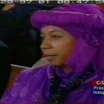 The American President and the Muslim Sister in the Majestic Purple Headdress
