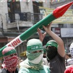 Masked Palestinian Hamas supporters hold a mock Hamas rocket during a protest against the Israeli offensive in Gaza, in the West Bank city of Nablus August 1, 2014.