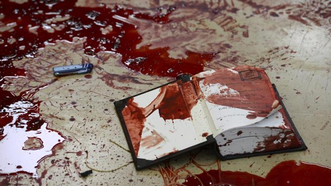 Scene from horrific attack at the Kehilat Yaakov synagogue.