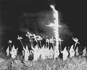 KKK cross burning, Gainesville GA, December 31, 1922. Photo Source: Wikimedia Commons, Public Domain. https://en.wikipedia.org/wiki/Ku_Klux_Klan