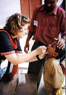 Child receives oral polio vaccine. (Via Wikipedia; used under CC license.)