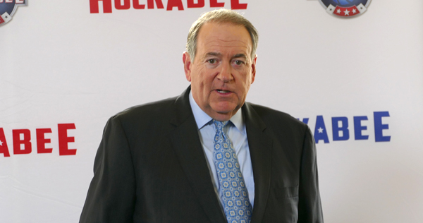 Former Arkansas Governor and presidential candidate Mike Huckabee speaks to during a press conference for his new TBN show 'Huckabee.'