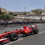 Formula One Scuderia Ferrari team driver Giancarlo Fisichella drives a Ferrari F60 past The Tower of David and the ancient walls of Jerusalem's Old City, during the second day of the Jerusalem Formula Peace Road Show