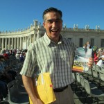 Yours truly in St. Peter's Square holding a copy of his book, Return to Rome