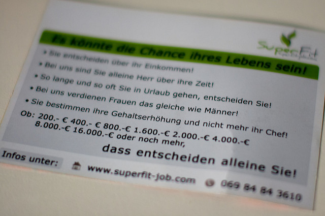 An MLM spam postcard someone received. In German, it gives the standard sales pitch: work for yourself! Decide your hours! Etc. (Markus Tacker, CC-ND.)