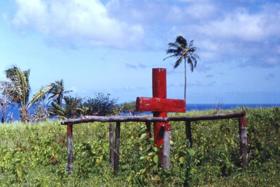 A cross adorning the site of a cargo cult. (Tim Ross, CC.)