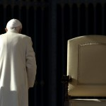 (Reuters/Stefano Rellandini) Pope Benedict XVI walks past the seat where he presided as head of the Catholic Church in Rome. (November 16, 2013)