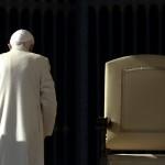 (Reuters/Stefano Rellandini) Pope Benedict XVI walks past the seat where he presided as head of the Catholic Church in Rome. (November 16, 2013)
