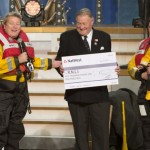 Mr Peter Tarrant (left) of the Royal National Lifeboat Institution expressed his gratitude to the L. Ron Hubbard Foundation and the Church of Scientology
