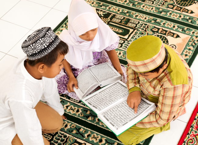 Children studying the Koran (Photo by Distinctive Images/Shutterstock)