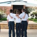 Three-boys-entering-church