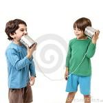 two-boys-talking-tin-can-phone-16468325