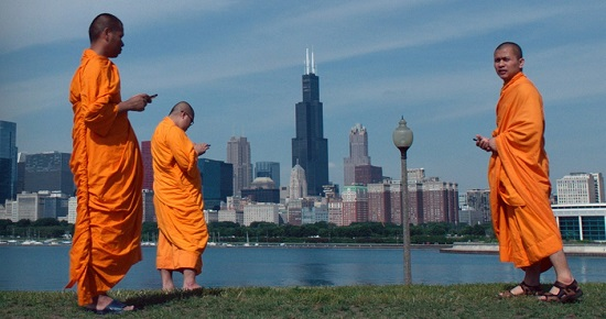 """In an image from """"Lo and Behold,"""" even Buddhist monks stay connected in the 21st Century"""