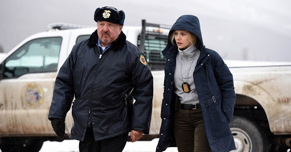"Graham Greene and Elizabeth Olsen, in ""Wind River"""