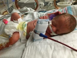 Grayson in his NICU bed