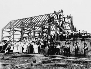 Barn raising. Image by Alexander W. Galbraith via Wikipedia. Public domain.