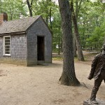"""""""Replica of Thoreau's cabin near Walden Pond and his statue"""" by RhythmicQuietude at en.wikipedia. Licensed under CC BY-SA 3.0 via Commons - https://commons.wikimedia.org/wiki/File:Replica_of_Thoreau%27s_cabin_near_Walden_Pond_and_his_statue.jpg#/media/File:Replica_of_Thoreau%27s_cabin_near_Walden_Pond_and_his_statue.jpg"""