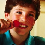 boy eating beet for some reason