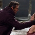 "Hugh Jackman and Anne Hathaway star as Jean Valjean and Fantine, respectively, in ""Les Miserables,"" the big-screen adaptation of the long-running stage show. (Universal Studios)"