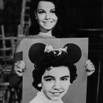 Publicity photo of American entertainer Annette Funicello (circa 1975) holding a photograph of herself as a child star on The Mickey Mouse Club (circa 1955–1958).  (Courtesy of Wikipedia Commons)