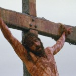 "Actor Jim Caviezel portrays Jesus on the cross in a scene from ""The Passion of the Christ."" (CNS/Icon)"