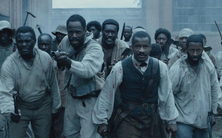 "Nate Parker, second from right, as Nat Turner in ""The Birth of a Nation"" (Photos by Fox Searchlight Pictures)"