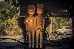 Sculptures holding lightbulbs