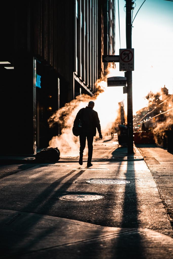 Man walking on a chilly morning to work.