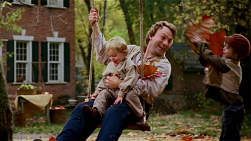 JS with child on swing