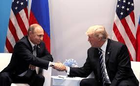 Trump and Putin shake hands