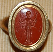 Red Jasper Intaglio, depicting a triple image of Hekate bearing Torches.  © The Trustees of the British Museum