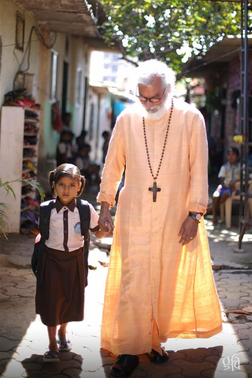 KP Yohannan and Bridge of Hope child - Gospel for Asia