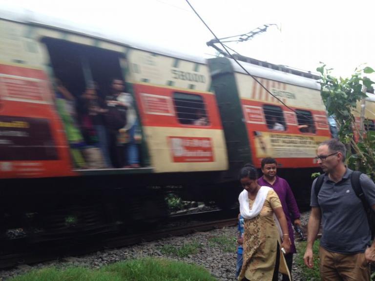 train speeds through the middle of the slum - KP Yohannan - Gospel for Asia