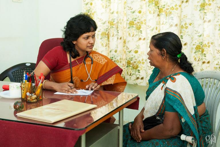 Treating a woman at a Gospel for Asia Medical camp - KP Yohannan - Gospel for Asia