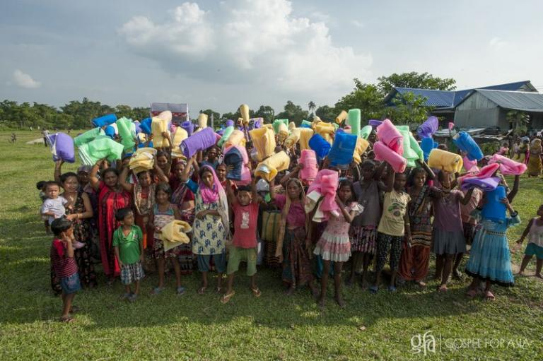 A community receives mosquito nets - KP Yohannan - Gospel for Asia